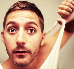 Undress (Damien Cox) Tags: uk gay portrait selfportrait man male me face self ego myself beard golden eyes hand masculine moi headshot homo homosexual vest queer scruff stubble singlet sigma30mmf14exdchsm