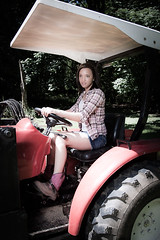 Down on the farm with Speakeasy Lingerie and Modeling (OregonVelo) Tags: pink red woman white tractor female jean boots skirt lingerie cowboyboots whiteshirt speakeasylingerie speakeasymodeling keithweldon