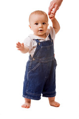 Small child in jeans with mom's hand (vankadanik) Tags: portrait baby cute male mom kid infant child hand small jeans 612months isolated babyboy oneperson caucasian