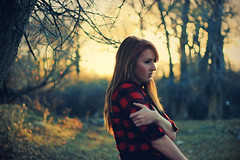 Some of those embers still glow, (-Fearless-) Tags: lighting trees light sunset shadow red summer portrait sun sunlight selfportrait tree girl leaves forest self person lights spring branch shadows bokeh branches redhead flannel trunks