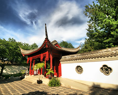 Peaceful Garden in Montreal (` Toshio ') Tags: park blue trees roof red sky canada building nature architecture garden asian pagoda asia montreal canadian structure walkway chinesegarden botanicalgarden hdr highdynamicrange toshio