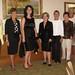 Dorothy Hasselberger, Judy Ward, guest model, Haven Hardin, Karen Moe, Joan Fiorillo, Barb Heideman and Denise Zutz strike a pose.