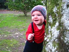 Oscar (Heart felt) Tags: trees winter baby grass hat moss sticks oscar exploring textures bark naturalworld