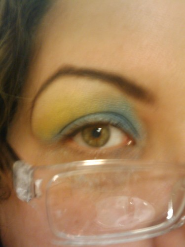 Light blue eyeshadow with a bright yellow burst of color and a neutral highlight