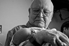 Elderly man holding baby