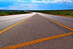 Roads That Don't End And Views That Never Cease (SeekayofRome) Tags: road sky sun newmexico lines yellow clouds nikon highway pavement asphalt desolate barren beams d5000