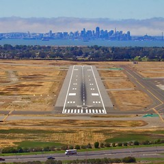 High as a Kite (Chris Saulit) Tags: sanfrancisco california fog airplane oakland fly flying airport oak flight aerial norcal approach runway doritos marinelayer generalaviation koak 27r