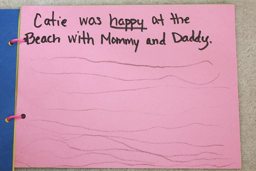 """Catie was happy at the beach with Mommy and Daddy"""
