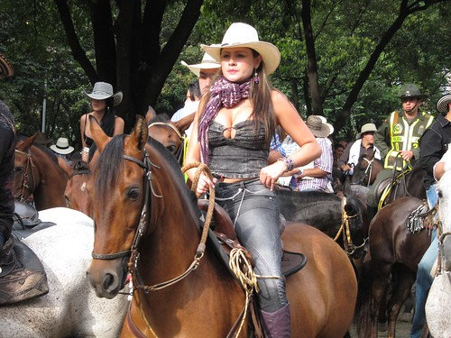 One of the many women riding horses in La Cabalgata.