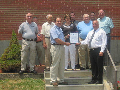 Certificate Presentation:   Row 1 (l to r):  Hardy Telecommunications General Manager D. Scott Sherman and USDA Rural Development State Director Bobby Lewis.  Row 2 (l to r):  Gerald Smith, Board Director; Arlie W. Funk, Board Secretary; Phyllis B. Cook, Board President; Loring E. Barr, Board Vice-President; and Harold Michael, Board Member.  Row 3 (l to r):  Greg Zirk, Board Member; Chris Strovel, Field Representative for Rep. Shelley Moore Capito; and Stanley Moyer, Hardy County Commission.