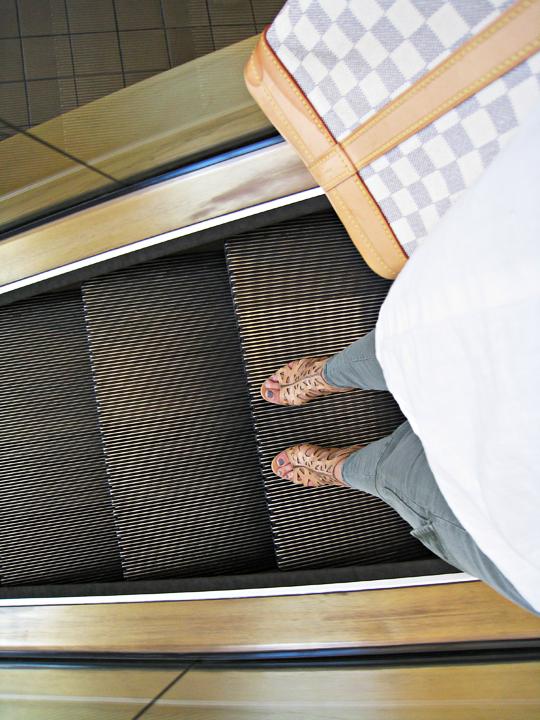 on the escalator+louis vuitton bag+j brand houlihans