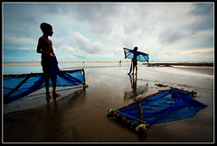 The metamorphosing butterflies [..Kuakata, Bangladesh..] (Catch the dream) Tags: life blue net beach children fishermen lifestyle translucent transparent cloth sands seashore bangladesh preparation hunt fishingnet seabeach kuakata patuakhali kuwakata kwakata gettyimagesbangladeshq2