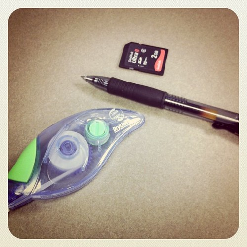 Things I can't survive without: Liquid Paper Dryline Grip, Pilot G-2 gel pens, and SD cards.