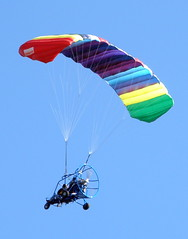 Flying Machine (Chris C. Crowley) Tags: plane catchycolors colorful flight parasail airborne motorized flyingmachine canaveralnationalseashore usaunitedstatesofamerica itsmulticolored chriscrowley anythingdigital celticsong22 eldorahouse