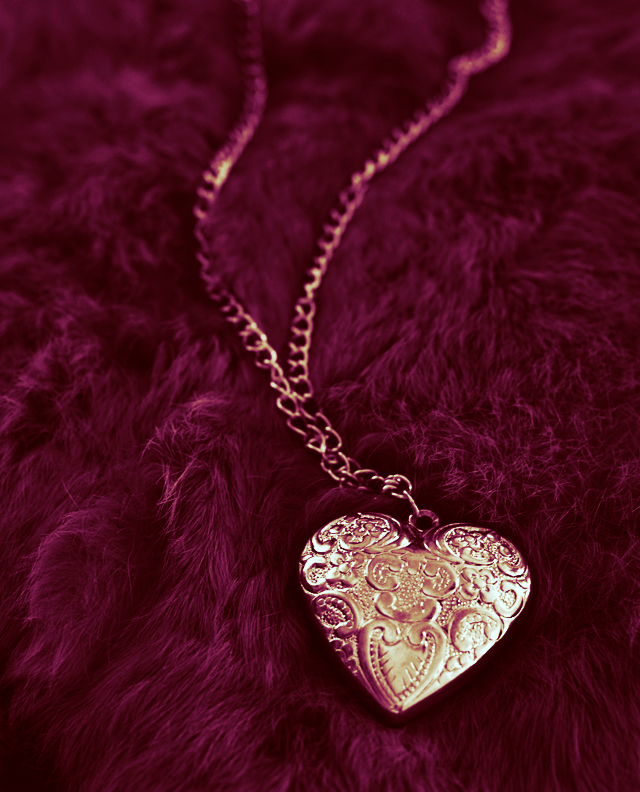 gold DIY heart pendant necklace on pink fur