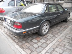 Jaguar XJ Executive (Transaxle (alias Toprope)) Tags: auto street urban berlin green cars beauty car rain sedan nikon afternoon power shot 1996 neglected snap chrome coche soul 1997 jag jaguar 1995 autos 1994 february common legend saloon kerb curb  macchina limousine x300 coches toprope underthebridge kerbs curbs xj luxurycar xj6 youngtimer britishracinggreen brg 2011 4door 6cylinder 4litre   commoncar commoncars