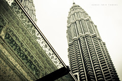 the bokeh towers ([ embr ]) Tags: city architecture canon buildings eos bokeh towers sigma malaysia kualalumpur kl petronastwintowers 30mm 1000d