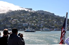 People Taking Pictures on a Ferry Boat as the Fog Approaches Sausalito, California (Blue Rave) Tags: building buildings people flag fog sausalito marincounty california ca