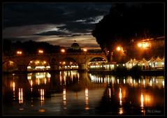 Festa sul fiume (mclinus) Tags: bridge sunset clouds reflections river tramonto nuvole fiume ponte cupola dome tevere festa sanpietro riflessi mywinners mclinus thetornskyuponspietro ilcielostracciatosoprasanpietro
