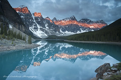 Moraine Lake (Grant Ordelheide) Tags: light lake snow canada water rock sunrise landscape bc britishcolumbia northamerica banff lakelouise canmore moraine mountian 2010 morainelake valleyofthetenpeaks lightband grantordelheide morainelodge