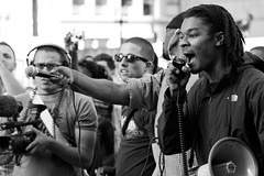 Protesters Use Bullhorns To Confront Police, Oakland Riots 2010 (Thomas Hawk) Tags: california bw usa america oakland riot unitedstates unitedstatesofamerica protest eastbay riots oscargrant oaklandriots oaklandlocal johannesmersehle oaklandca070810 oaklandriots2010