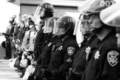 A Line of Riot Police, Oakland Riots, 2010 (Thomas Hawk) Tags: california bw usa oakland riot cops unitedstates 10 unitedstatesofamerica protest police eastbay riots oaklandpd fav10 oaklandpolicedepartment oscargrant oaklandriots oaklandlocal johannesmersehle oaklandca070810 oaklandriots2010