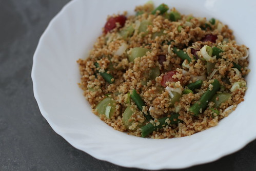 Roasted couscous, grapes, gooseberries and spring onions