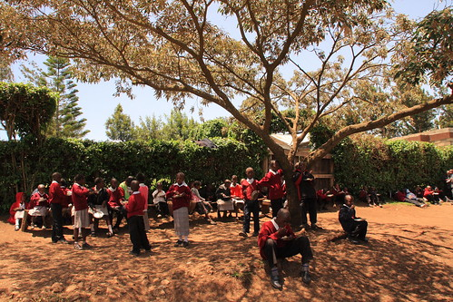 Eating lunch cooked on biogas - Tania School - under the tree