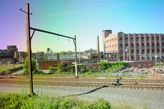 Post-Industrial Landscape (alankin) Tags: abandoned philadelphia buildings geotagged cityscape pennsylvania decay wideangle powerlines wires 100views rails fromthetrain inpassing windowview philly septa pylons postindustrial urbanlandscape redbrick r8 tioga trainline fauxvintage 17mm niknala electricpowertransmission nikond300 chestnuthillwestline 23may2008 0800029amu nikkorafzoom1755mmf28g geo:lat=40002627 geo:lon=75162703