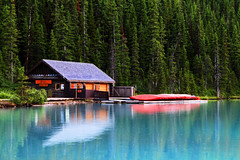 Cabin on Lake Louise (Jim Boud) Tags: travel blue red lake canada blur reflection building tree green nature water pinetree canon lens landscape outdoors eos boat is nationalpark cabin colorful hiking dream wideangle canadian outoffocus canoe sharp shore alberta northamerica banff usm dslr lakelouise dreamlike 1785mm digitalrebel photoart digitalslr pinetrees efs1785mmf456isusm province orton blend gaussianblur firtree waterscape artisticphotography infocus canadianrockies imagestabilization imagestabilized 550d jimboud t2i michaelorton topazadjust jamesboud eos550d kissx4