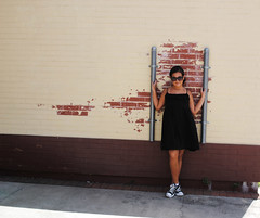 Love! (nikolina100) Tags: urban girl sunglasses fun orlando downtown florida sassy bricks converse chucks