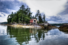 abandoned (almostsummersky) Tags: ocean wood trees red summer camp seaweed reflection building abandoned water weather clouds forest river landscape island coast dock woods rocks waves maine stormy estuary shore shack ripples hdr tides westbath newmeadowsriver