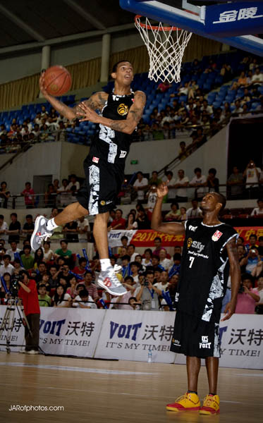 Guy Dupuy entertaining the crowd during halftime in Wuhan.