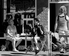 BUT HE LIKES TO SIT ON MY LAP....... (Akbar Simonse) Tags: street people urban dog holland netherlands coffee women candid streetphotography denhaag hond x conversation thehague gestures streetshot straat koffie gesprek straatfotografie gebarentaal straatfoto gebaren hofstijl akbarsimonse