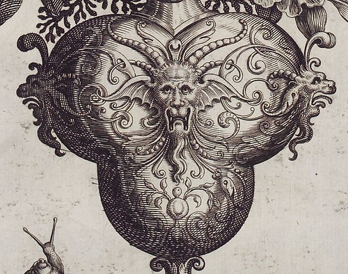 16th c. engraving detail of grotesque faces on vase by Theodore de Bry