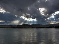 Boulder Reservoir (Kimberly Dickinson) Tags: sky lake storm mountains color nature water beauty clouds reflections landscape scenery colorado boulder sunrays sunbeams raysoflight boulderreservoir