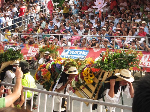 The people carrying the flower displays (silletas) are called silleteros.