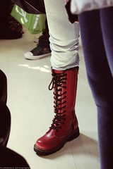 putting one [red] foot forward; (foldedmemos) Tags: light shadow red fashion train canon vintage boot shoe rebel carriage legs boots metro taiwan fake sneakers jeans crossprocessing faux denim taipei sexylegs docmartens shoelace shoelaces 500d ximendin