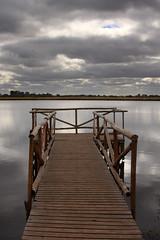 Laguna del Ojo (Gustavo Olivera) Tags: canon gris muelle madera agua buenosaires paisaje cielo nubes reflejo marron aire celeste 28105 sanvicente 40d 281053545 gustavoolivera lagunadelojo