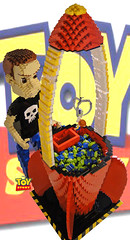 The Claw (Joel.Baker) Tags: sculpture game green buzz toy skull baker lego buzzlightyear crane joel space alien sid woody story theclaw skullshirt littlegreenalien lettle toystory1 spacecrane
