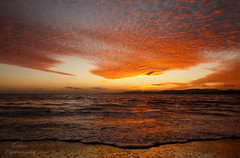 sunset (esther**) Tags: light sunset red sea sky sun reflection beach colors clouds island colorful wave greece rodos rhodes coucherdusoleil