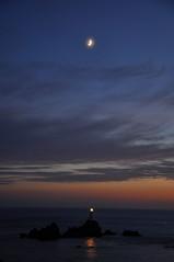 Navigation (Infinite Monkey) Tags: light sea sky moon lighthouse reflection skyline night clouds nikon rocks solitude jersey navigation atmospheric corbiere d90 chanelislands corbierelighthouse flickrchallengewinner thechallengefactory