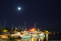 Snug Harbour / Marina (Dana Brady) Tags: moon lake ontario water night port marina boats iso100 restaurant pentax harbour 28mm calm f45 credit lakeontario mississauga snug 20s portcredit snugharbour k200d pentaxk200d
