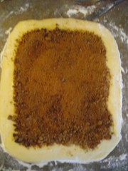 Brown sugar & cinnamon sprinkled on top of melted butter