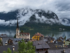 Hallstatt Rooftops (NatashaP) Tags: houses lake mountains church fog clouds landscape austria rooftops roofs explore hallstatt interestingness54 holidaysvacanzeurlaub