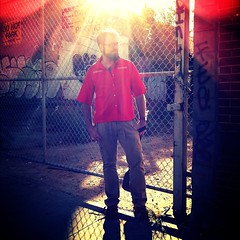 "52 Weeks of ""The One You Love"" (44): A Strange Visitor... (Sion+Anton) Tags: portrait brick graffiti streetportrait squareformat lensflare redshirt shadowsandlight 500x500 parkslopebrooklyn iphone4 iphoneography antonkawasaki beardedgaymalewithglasses astrangevisitor blindinglightoverhead lockedfencedgate donotparkheresigns camerabagformat126apps"