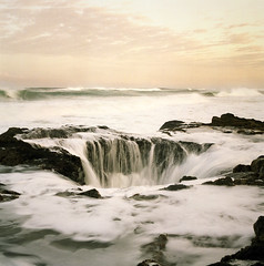 the pull of a restless ocean (manyfires) Tags: film water oregon sunrise mediumformat square coast rocks surf waves tide shoreline hasselblad foam pacificnorthwest oregoncoast splash muted capeperpetua splish hasselblad500cm 500px cookschasm thorswell