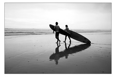 Surfers - Occasional creatures of the sea and sand (Mark-Crossfield) Tags: pictures uk greatbritain sea england blackandwhite reflection beach mono coast photo boards sand watergatebay cornwall surf waves image photos surfer sandy picture wave images surfing beaches surfers surfboards watergate wetsuits sandybeach bigwave photosof picturesof nearnewquay imagesof watergatebayhotel markcrossfield