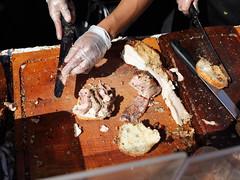 the chopping block (1600 Squirrels) Tags: sanfrancisco california food usa truck photo lenstagged pork rotisserie 1600squirrels sfbayarea nocal missiondistrict streetfair 25thstreet porchetta sanfranciscocounty 4x3 canon24105f4 roliroti 5dii sfstreetfoodfestival sfstreetfoodfestival2010