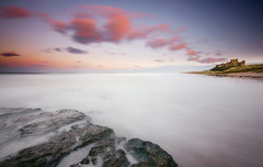 Bamburgh Castle Sunset (.Brian Kerr Photography.) Tags: longexposure pink sunset sea sky colour castle beach grass clouds coast rocks northumberland coastal shore northsea northeast bamburgh bamburghcastle briankerrphotography